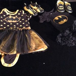 Two batman onesies for the super hero girls.
